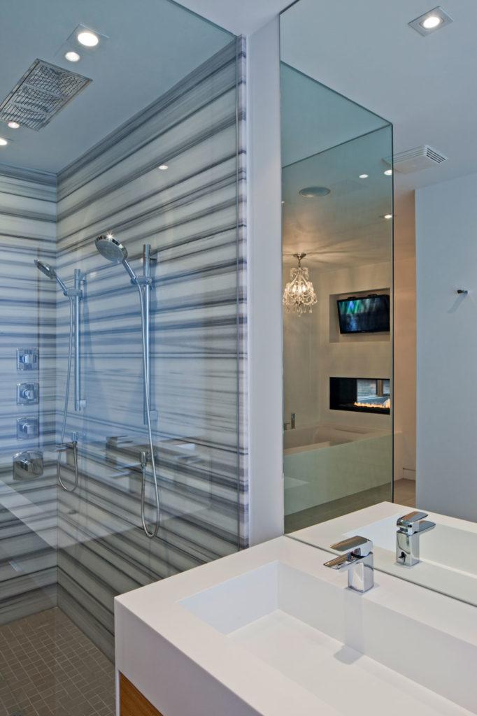 sleek modern bathroom with marble walls