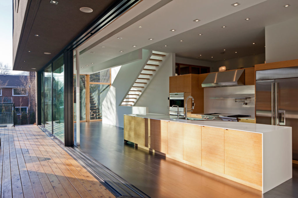 A modern home with sleek white and wood millwork.