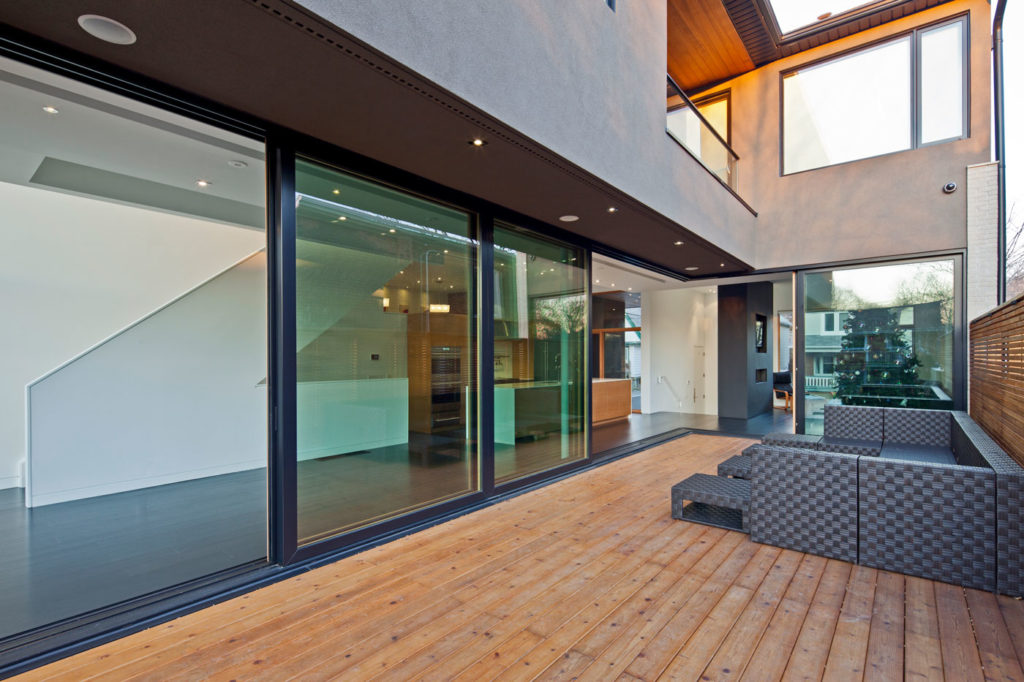 Exterior of a modern home with wooden deck