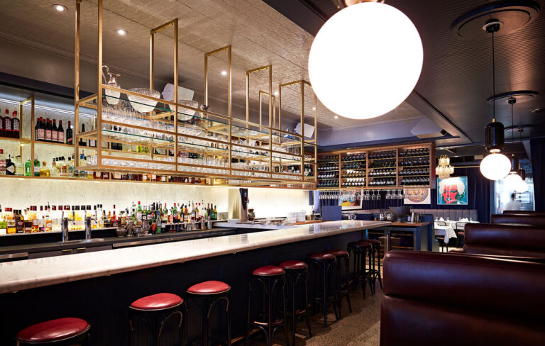 Bar with banquette seating along the wall.