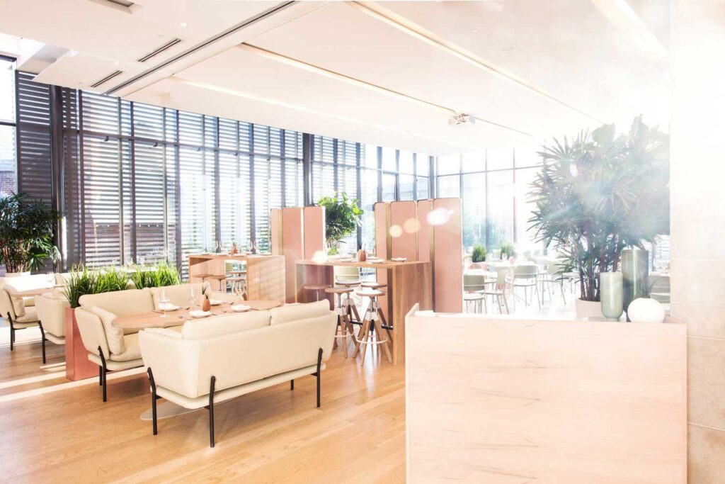 Sunlight streams into Clay restaurant, which looks modern with a pale and fresh colour palette.