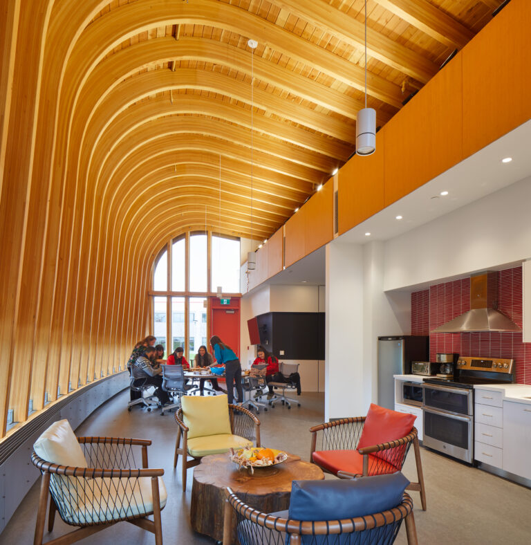 Inside Odeyto Indigenous Centre with curved wood ceiling.