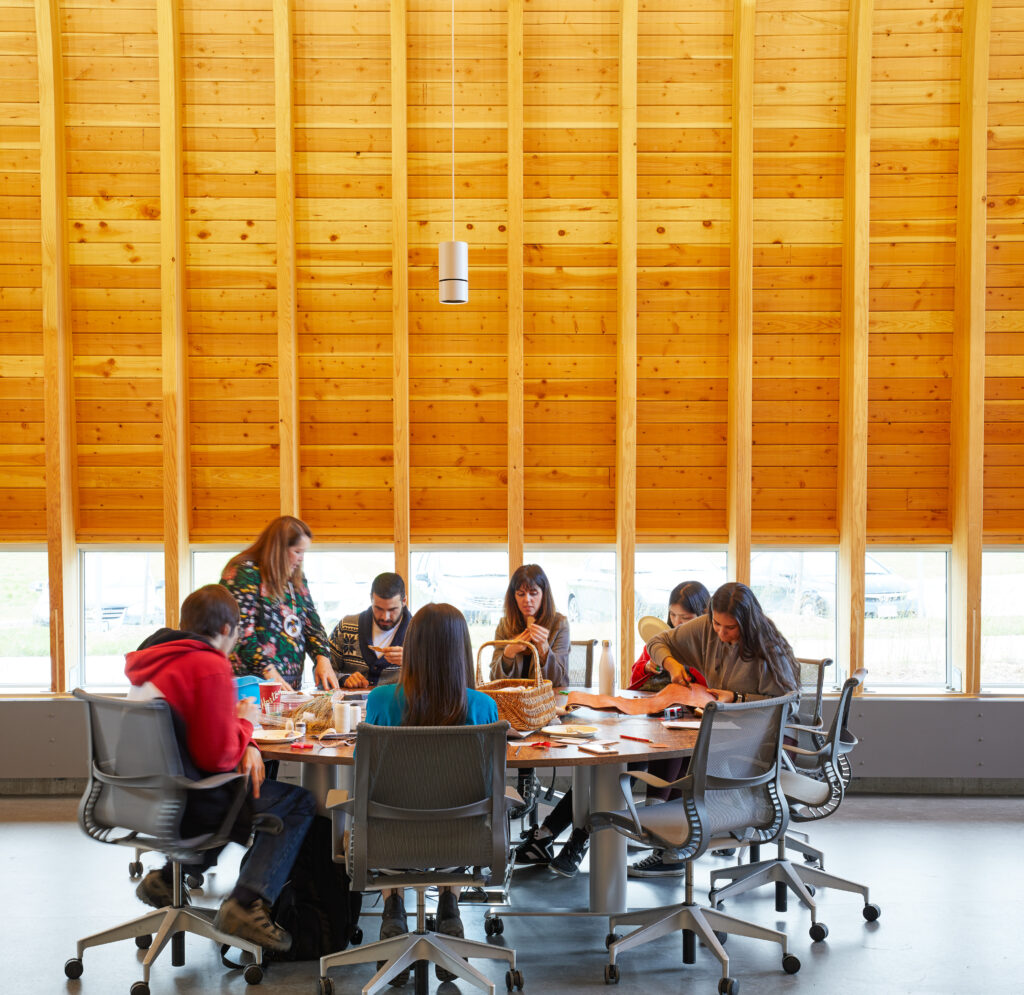 Students gathered around a round table at Odeyto Indigenous Centre.