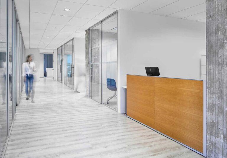 Modern office hallway, with glass doors