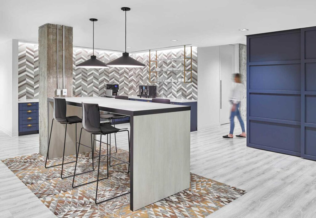 Workplace kitchen area with chevron tiles