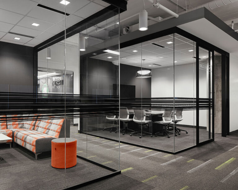 A meeting room with glass walls.
