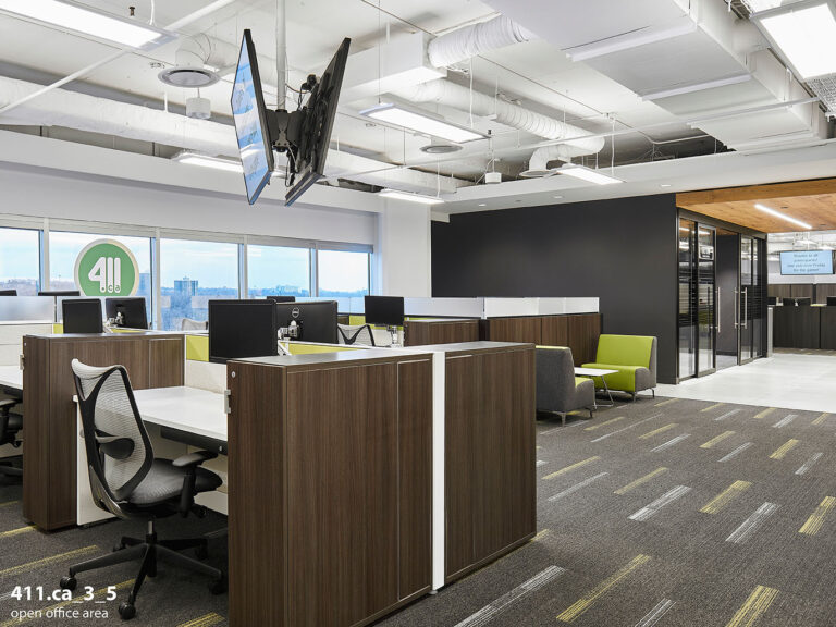 An open office layout, with a brown, gray and lime green colourscheme.
