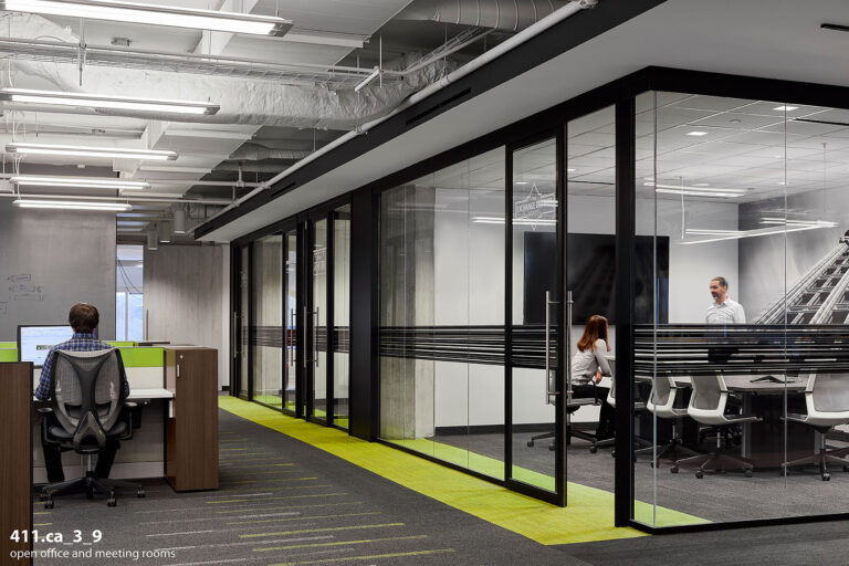 Open office and glass walled meeting rooms.