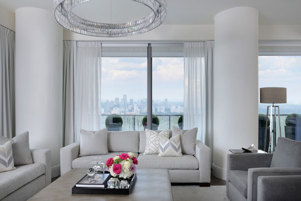 Living room in white and dove gray, with a view of Lake Ontario.