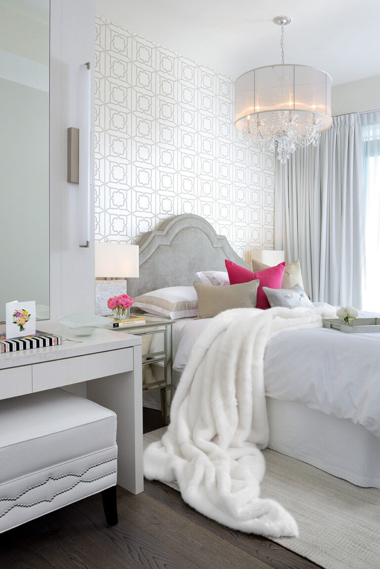 Pale gray bedroom with a white blanket cascade.