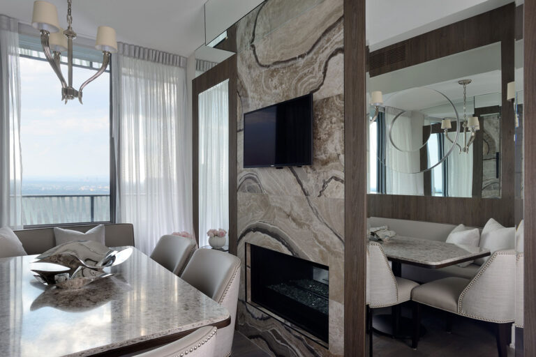 Small breakfast nook with mirrors on either side of a TV.