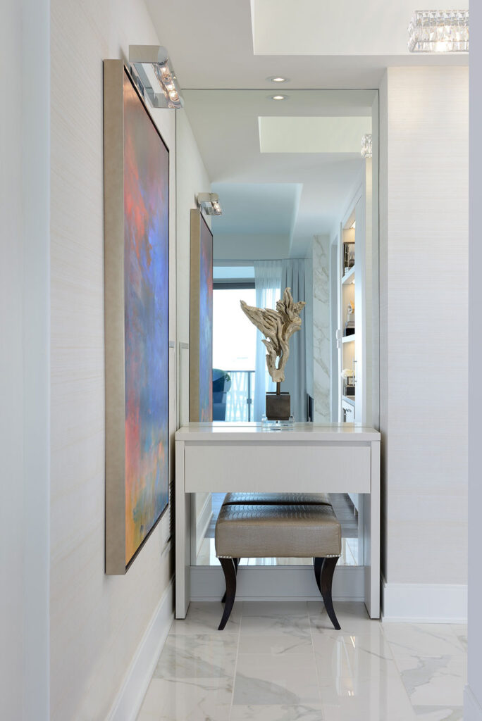 Small vanity against a mirrored wall.