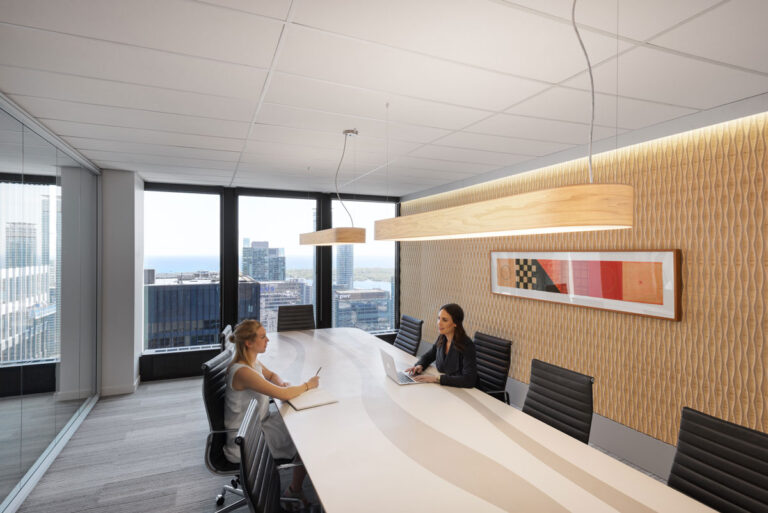 Office with tan wall and windows with large boardroom table
