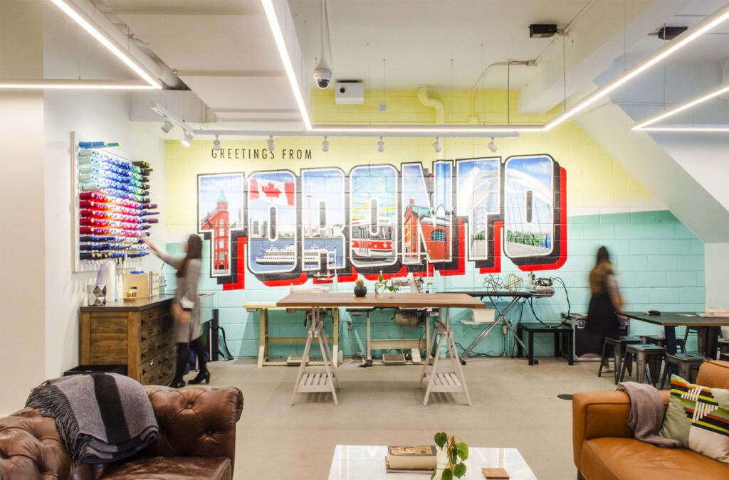 Retro mural depicting 'Toronto' with scenery in each of the words.