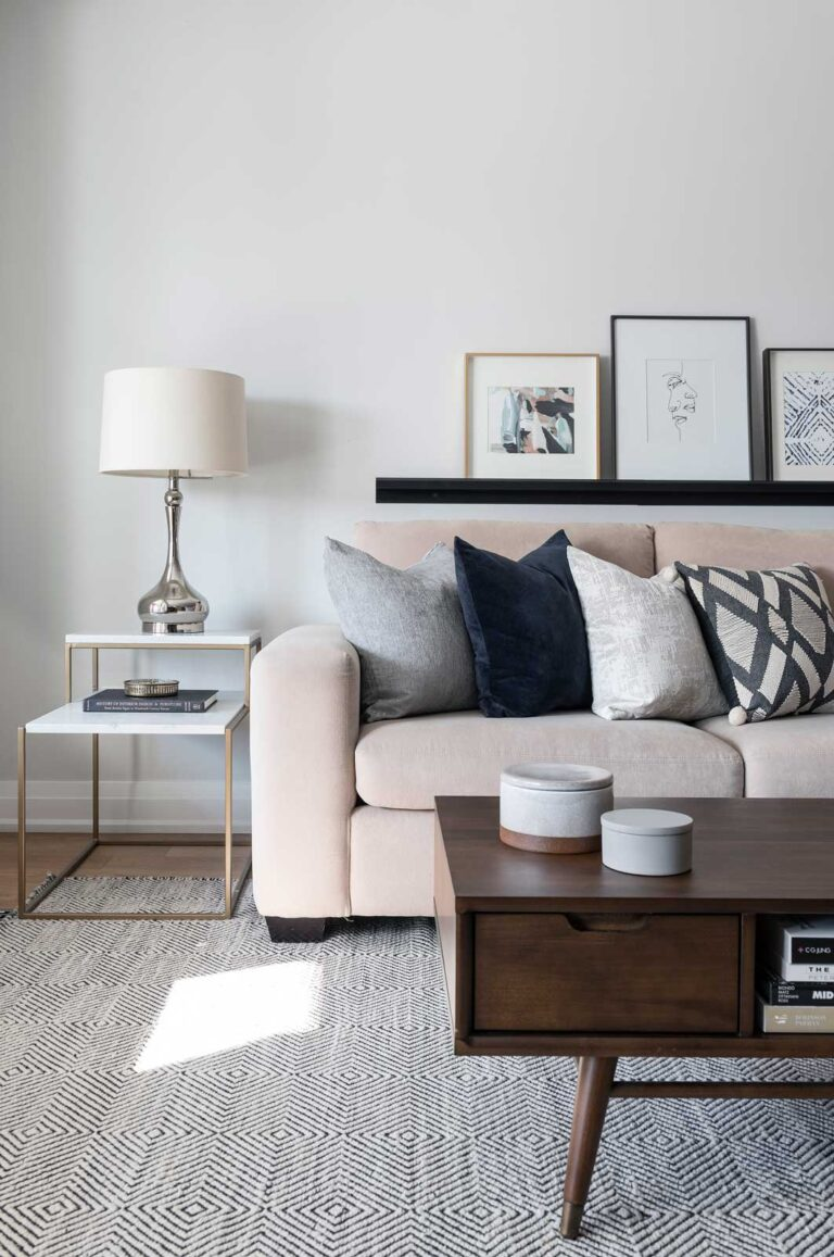 Pale pink couch with blue and gray cushions