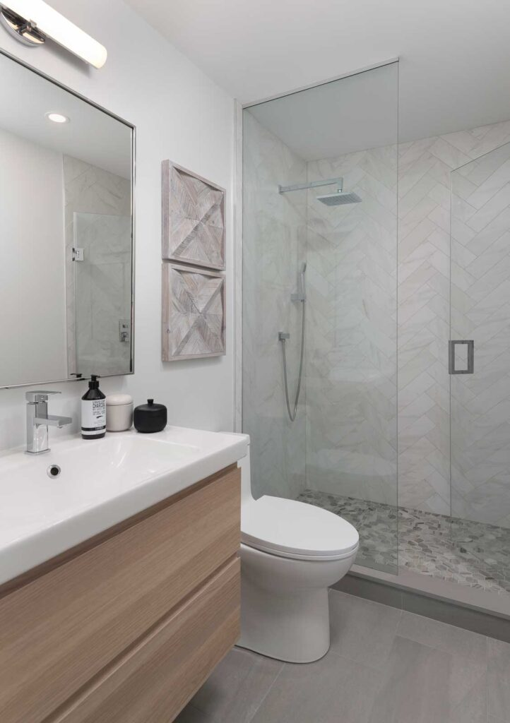 Toilet with glass walled walk in shower.