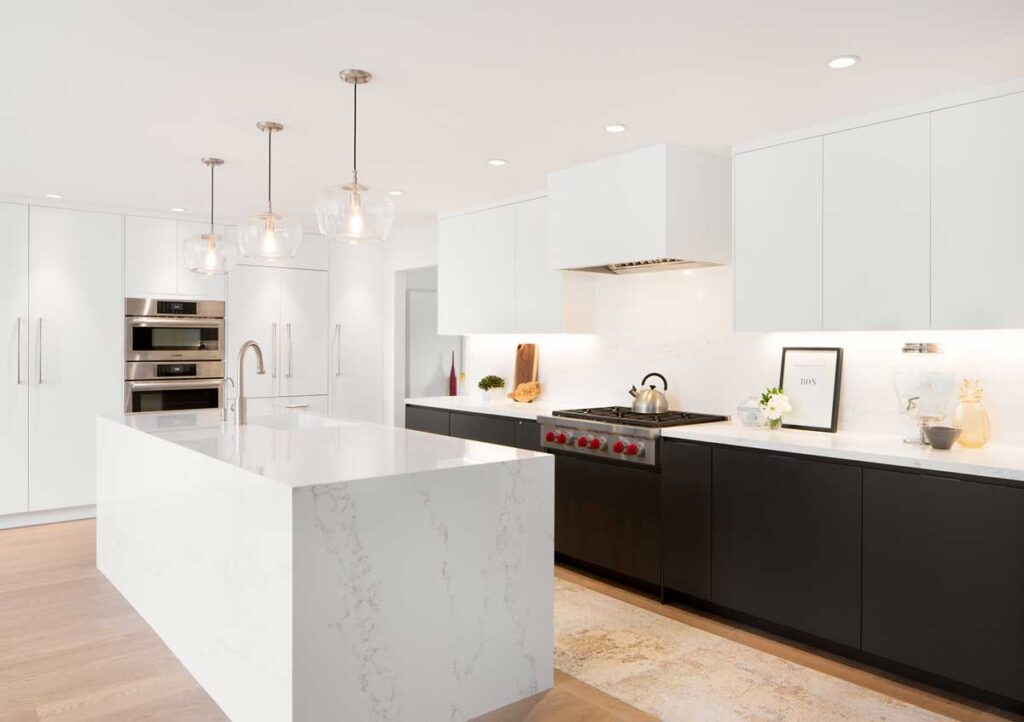 Modern white kitchen with marble island.