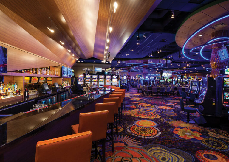 Casino area with bright lights and floral patterning.