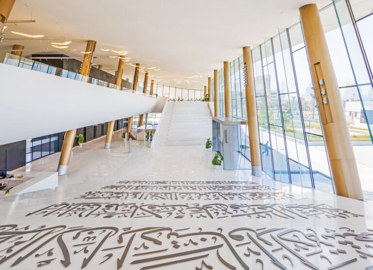 Marble covered atrium at Etihad Museum, with marble steps.