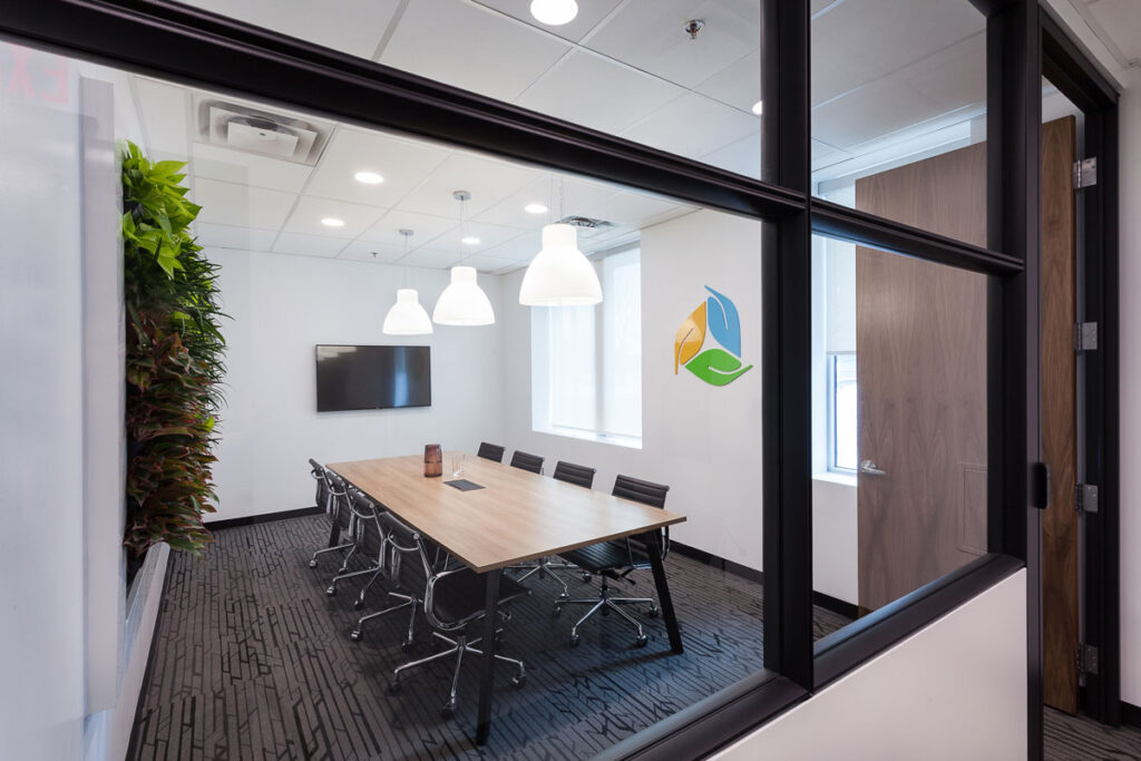 Exterior view of glass-walled meeting area at office.