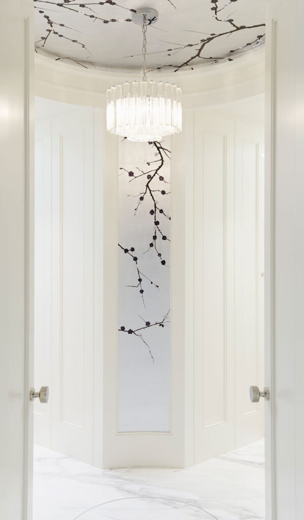 White entrance area with botanical drawings in black.