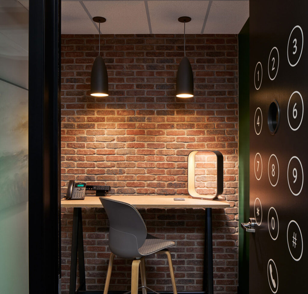 Focus room with brick walls and a standing desk.
