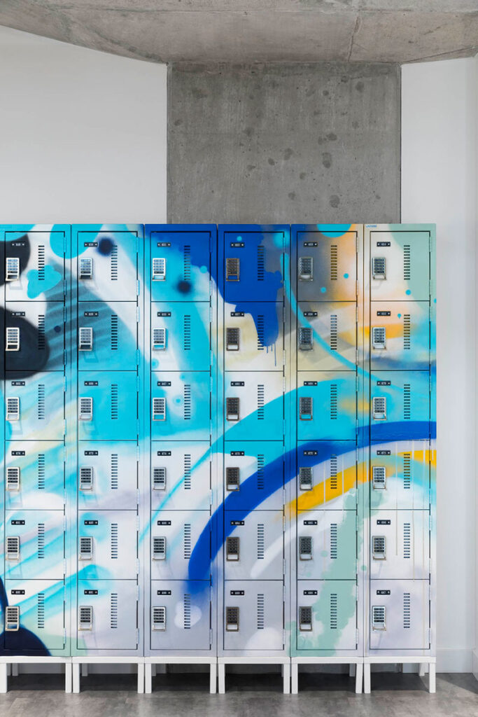 Lockers spray painted with blue, grays and white abstract patterns.