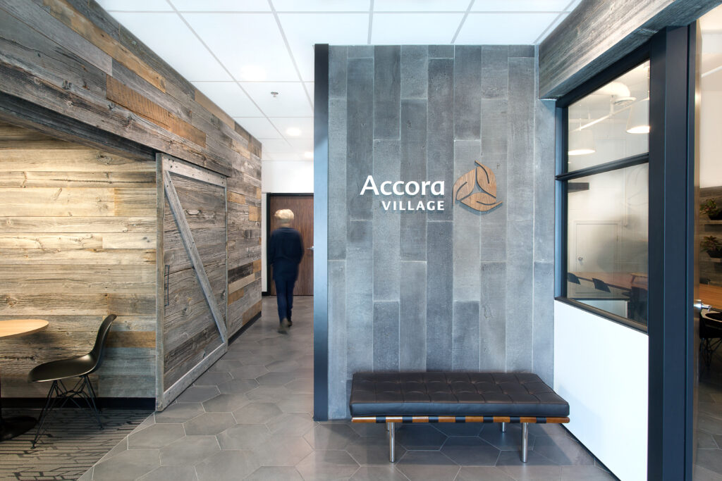 Slate walled accent wall with company sign.