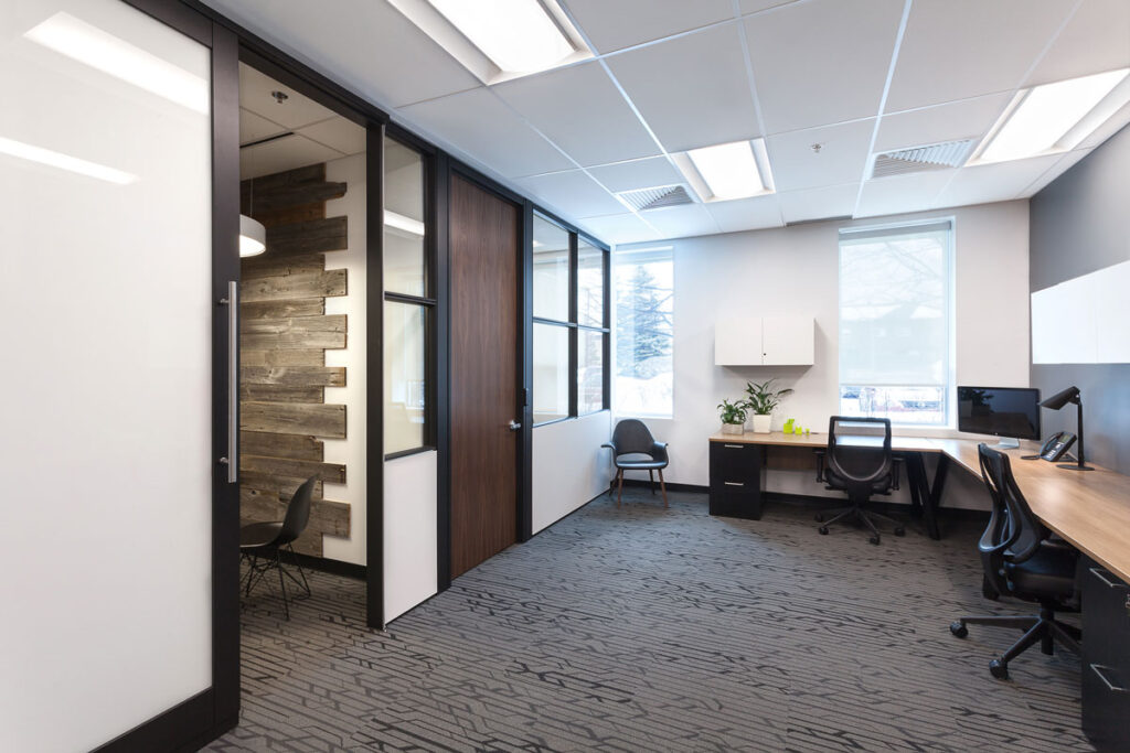 Office area with dark gray carpeting.