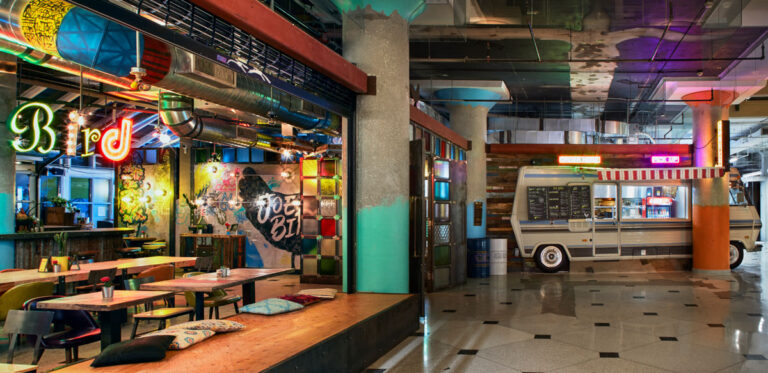 Ecclectic restaurant design with textured and coloured elements.