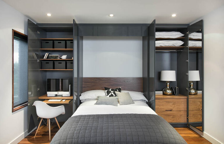 Murphy bed with millwork storage area.