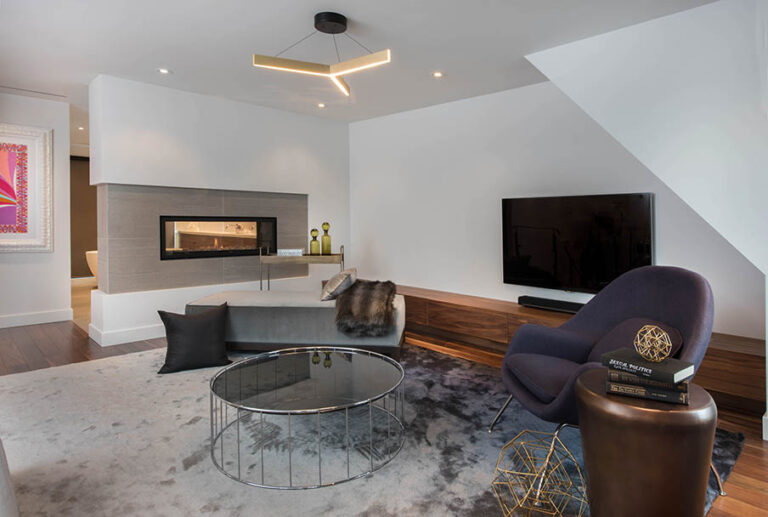 Lounge area with fireplace and cozy seating.