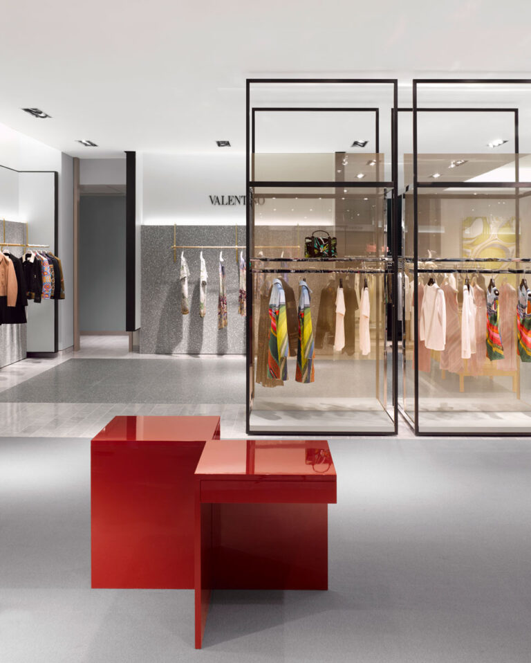 Store within store area at Neiman Marcus with open garment racks.