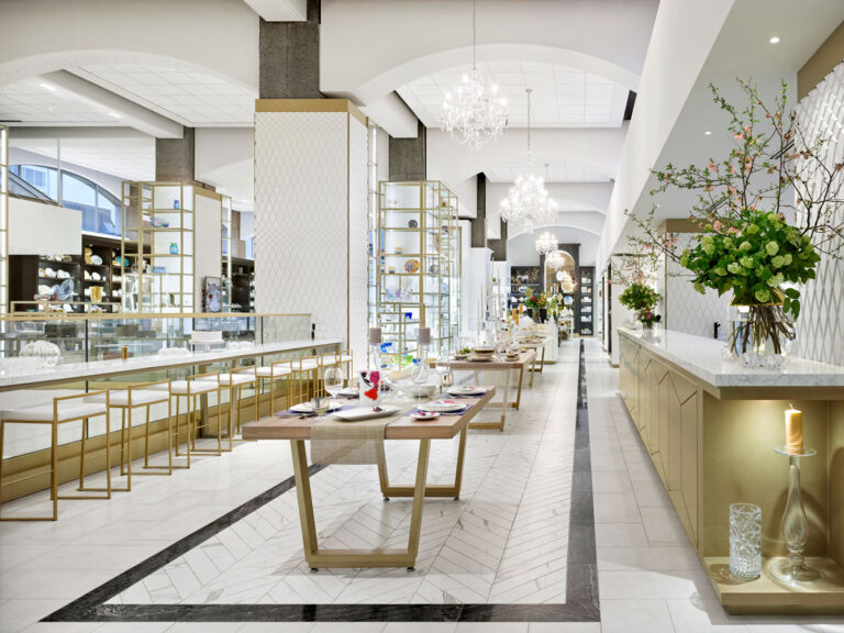William Ashley retail store with cream marble floors, arched ceiling, and gold and cream display cases.