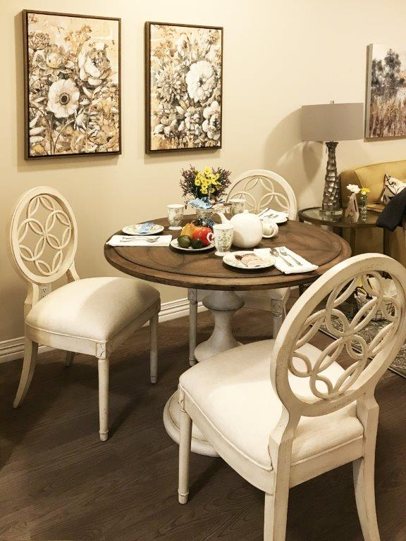 Bistro table with white chairs.