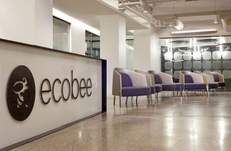 Reception desk at ecobee with graphic of company name and logo.