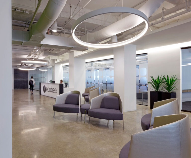 Reception and lounge area at ecobee with polished concrete floor and open ceiling.