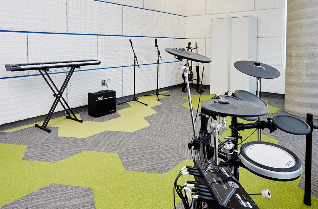Instrument room at Hamilton Public Library with sound-absorbing walls and hexagonal carpet tiles.