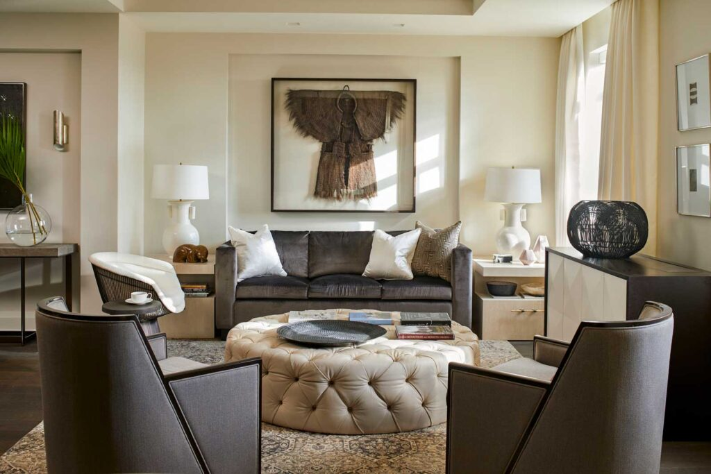 Luxe living room area in creams, browns and with cozy textured elements.