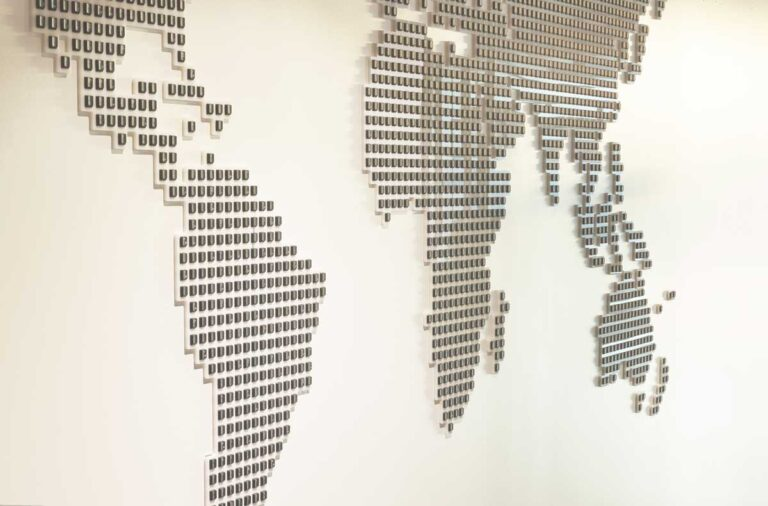 A world map made from keyboard keys represents the company