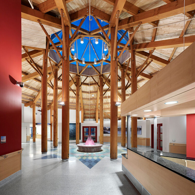 Tall timber columns and beams welcome everyone into the health centre with a large octagonal skylight at the centre.