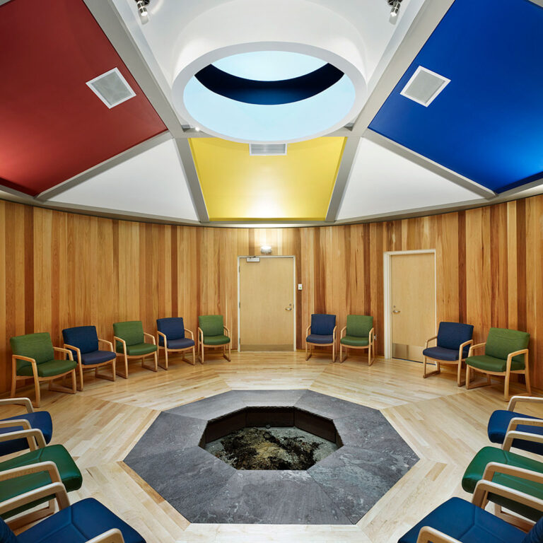 Cedar lines the walls and floors of the octagonal ceremonial room with an earth firepit at its centre.