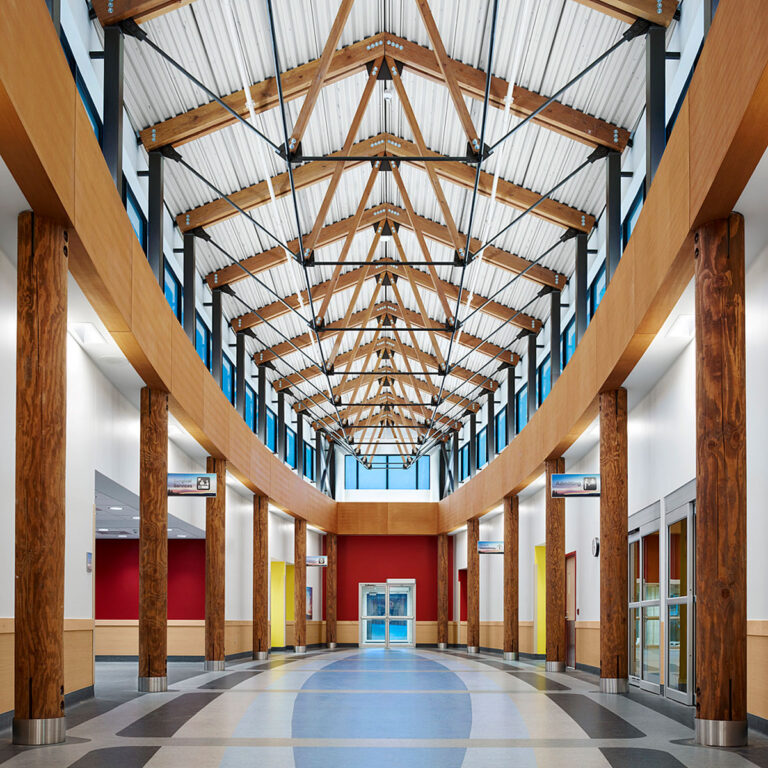 The canoe shaped Ambulatory lobby was built in structural timber with a clerestory window while the flooring underfoot recalls the natural flowing state of water.
