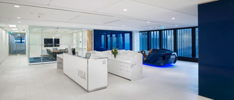 Reception area at Visa Canada office with brand white and blue on floors and walls, respectively.