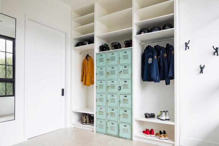Mudroom with shelves and lockers for kids sports gear.