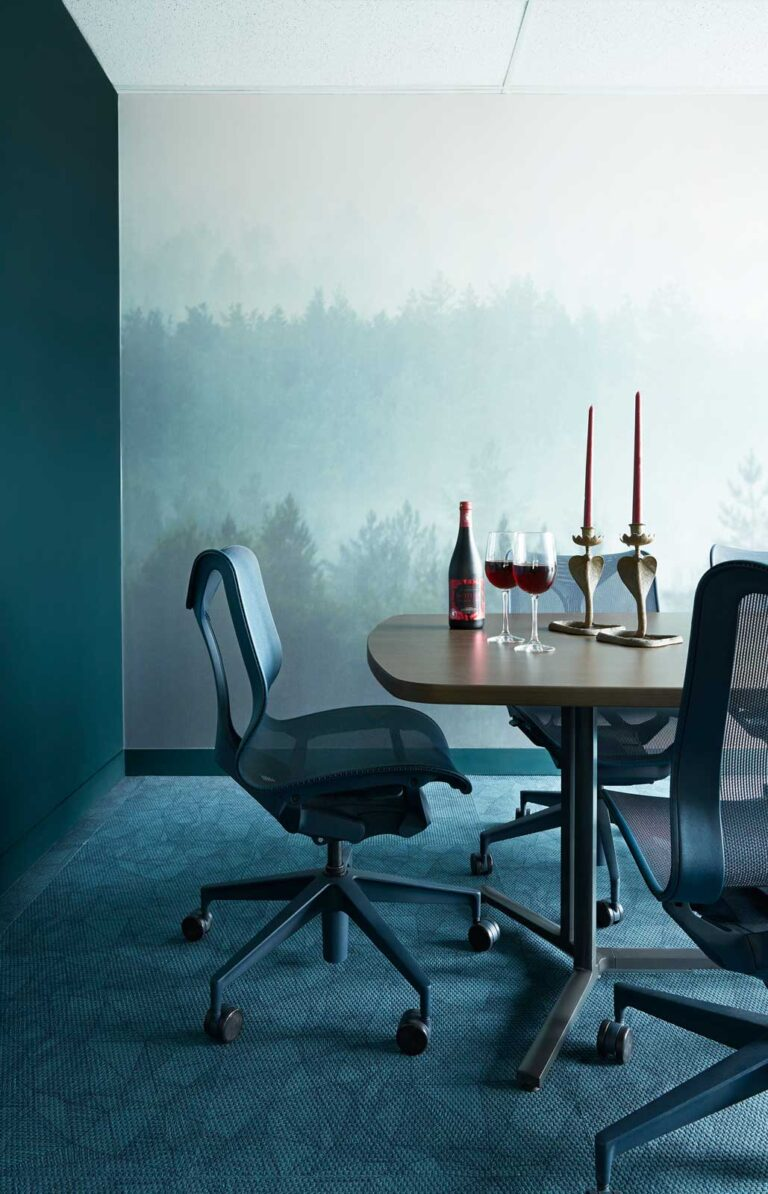 Detail of meeting room painted with a forest landscape.