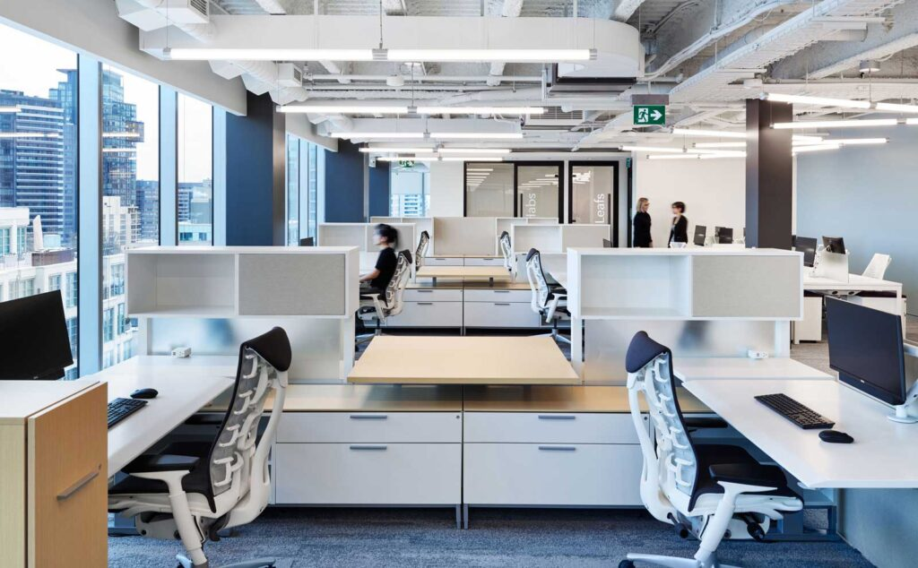 Open concept office space with white, gray and pale wood colour scheme.