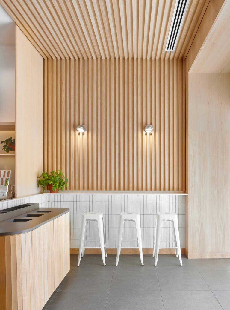 Tambour walls line the walls of this grab and go sandwich cafe.