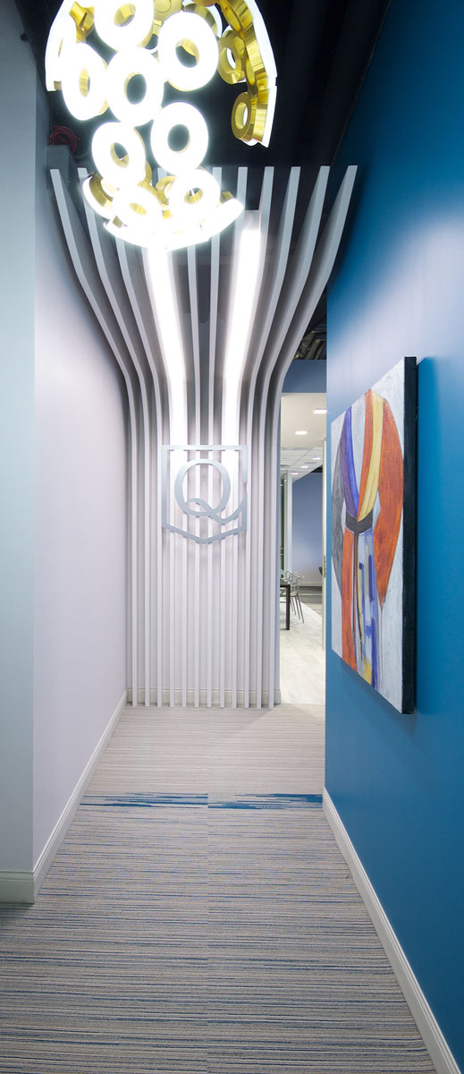 An eye-catching millwork element welcomes students and leads them into the space, with a cut out brand element.