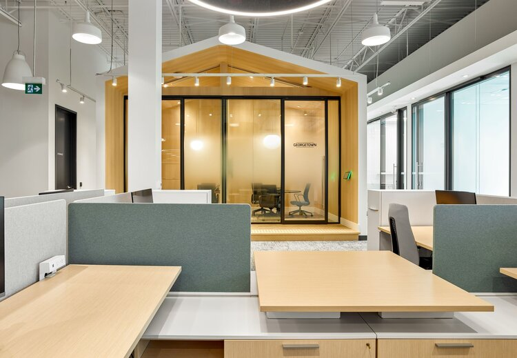 Meeting and work space is adjacent to a special meeting area built to look like a cabin in the office space.